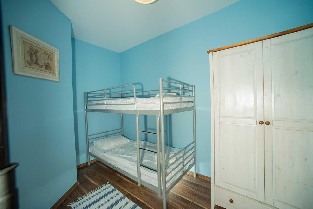 Piętrowe łóżko w Apartamencie Pirania , w Pensjonacie Villamare w Kołobrzegu