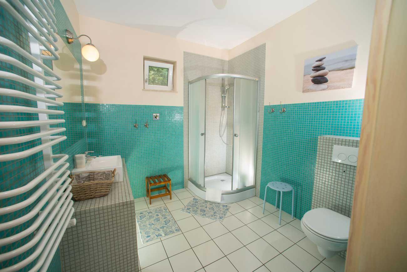 Widok na łazienkę w Apartamencie Pirania