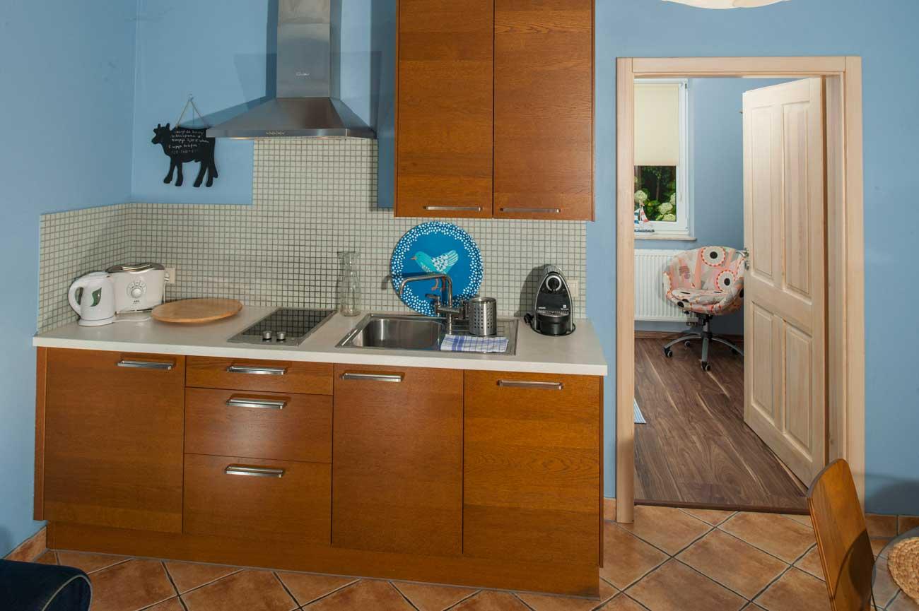 Pokój i kuchnia w Apartamencie Pirania , w Pensjonacie Villamare w Kołobrzegu